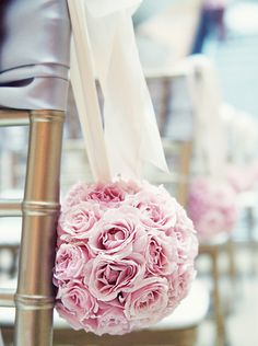 Pomanders of Pink Spray Roses hang from Gold Chiavari Chairs