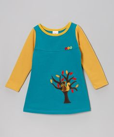 Featuring a mix of bright colors, a pitter-patter critter appliqué and decorative buttons on the bodice, this sweet dress is full of fun. It's comfy too with a pullover fit and swing silhouette that makes twirling a natural reaction. 65% cotton / 35% polyesterMachine washImported