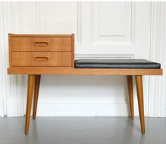 something like this for hall with simple hooks on wall above - drawers handy for keys etc