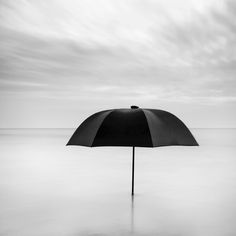 Lone umbrella in the sea