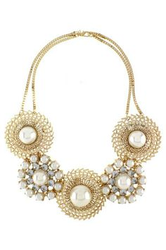 Pinwheel pearl and bejeweled circles lavish this gold tone necklace. Truly skinny jean or evening gown worthy! Available at www.blatantjewels.com