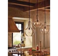 These rustic/modern lights are from the  Everly Collection by Kichler. They have such a unique look with the large glass bowls. We think they look amazing over this kitchen island!