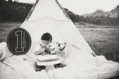 Ezra 1 Year Old Baby Boy Cake Smash with Jenna Wren from The Road Home Photography in Colorado Springs, Colorado #english #bulldog #puppy #birthday #cake #smash #ideas #teepee #1 #yearold #baby #boy #overalls #oshkosh #colorado #family #portrait #ideas #summer #colorado #birthday #cake #ideas #black #white #quilt #creative #children #photography #tips