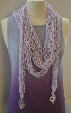 $24***Handmade Crochet Scarf - Lavender With Crochet Tassels ***Length:12 feet***Scarf is very airy and it drapes beautifully around the neck***It has crochet tassels at the ends***The color is mainly lavender with white accents***For more unique items please visit: http://www.etsy.com/shop/TsEclecticCorner