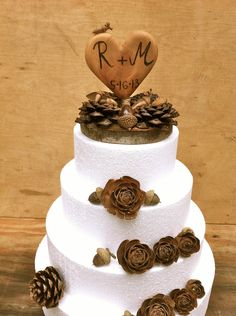 "Rustic Wedding Cake Topper Wooden Customized Heart 5"" forest pine cone country winter decorations. $45.00, via Etsy."