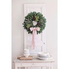 A @wintersteenfarms wreath and our grain sack ribbon we make and sell in our shop. @wintersteenfarms wreaths are one of my favorite gifts to give during the holidays ;) you can also still enter our giveaway on the blog for a chance to win one.