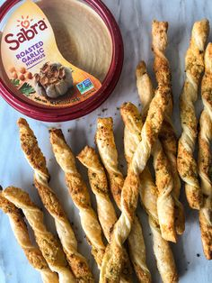 Easy Coronavirus Quarantine Recipes: Sabra Garlic and Chive Puff-Pastry Straws - PureWow Roasted Garlic Hummus, Garlic Chives, Puff Pastry Recipes Savory, Frozen Puff Pastry, Vegetarian Cheese, Soup And Salad, Bread Baking, Finger Foods, Food Porn