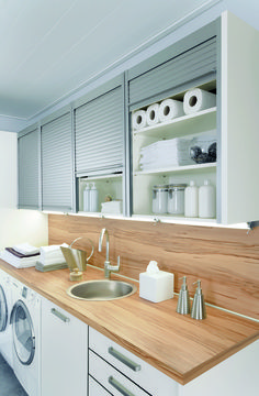 Get REHAU Tambour Doors in your laundry room today! Shop this look at: www.rehau.com/us-en/furniture/surfaces/metal/tambour-doors