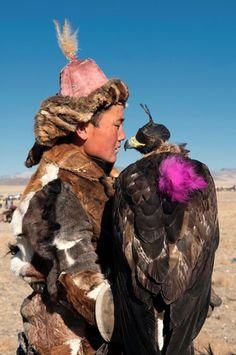 Kazakh eagle hunter and his golden eagle in the Altai Region of Bayan-Olgii in…