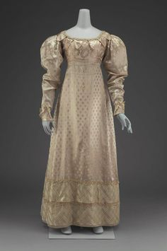 Dress: ca. 1825, American, silk figured satin, silk gauze, silk bobbin lace, silk cord trim, and linen lining.
