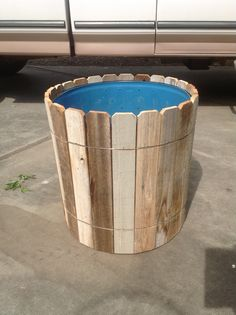 My husband made out of a large plastic barrel. DIY old fencing glued and wired o… - Garden Design Plastic Barrel Planter, Wooden Planter Boxes, Wood Planter Box, Plastic Barrel Ideas, Diy Wood Projects, Wood Crafts, Patio Grande, Large Backyard Landscaping, Old Fences