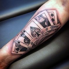 Man walking city street with playing cards upper arm tattoo poker and dice tattoos card for men. Card Tattoo Designs, Tattoo Arm Mann, Playing Card Tattoos, Poker Tattoo, Cool Playing Cards, Zealand Tattoo, Geniale Tattoos, Best Sleeve Tattoos, Tattoo Project