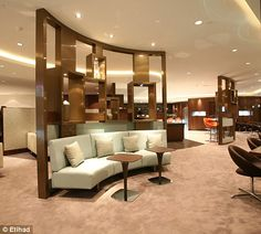 Luxury escape: The Etihad lounge has a Champagne bar and even a cigar lounge...
