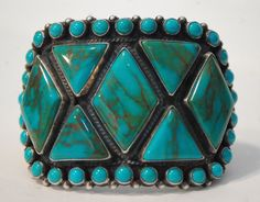 """Museam worthy beautiful vintage Navajo hallmarked stunning turquoise and heavy sterling bracelet 125 grams 2"""" tall"""