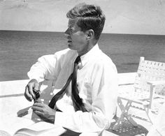"""I have never seen this photo before. I love it. The description reads: John F. Kennedy sitting on a boat in Cape Cod. Copyrighted by the New Bedford…"""
