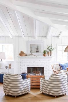 The White Ranch:  In this California home, it's all about scale. For example, hefty wingbacks would overpower the room (and break up the visual flow in the open space), but the high ceilings and abundance of white decor makes it feel airy and big.
