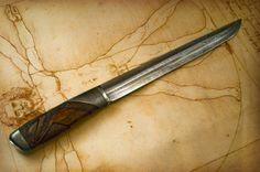 Ironwood Fighter by Roger Bergh  Blade: 5-Bar Explosion Pattern Damascus  Handle: Sterling silver, Desert Ironwood, Damascus Bolster  Size: Length ca. 30 cm