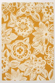 Yellow floral rug with rich dark paneling on bottom half of walls/navy paint on top half OR navy walls/bold white trim