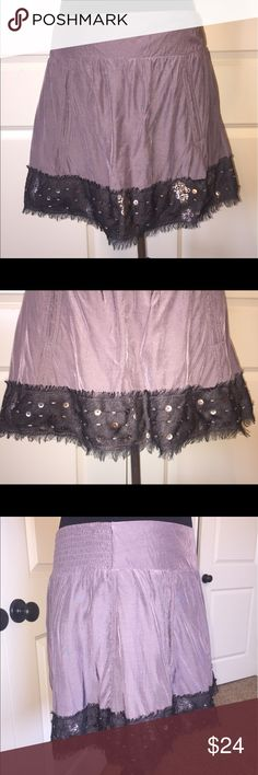 """Free People Embellished Skirt Free People embellished skirt. Cute skirt in a purple gray color with pretty trim at bottom adorned by beads and sequin. Can be dressed up or down. Lined. Faux pockets. Elastic waistband. 51% viscose/49% cotton. 15.5"""" length. Size S. In great condition. Only flaw is a small spot on back of skirt. It is not visible when wearing since it falls on the side of one of the pleats. Free People Skirts"""