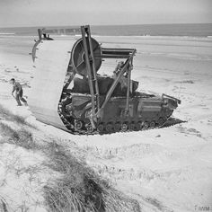 Churchill AVRE (Armoured Vehicle Royal Engineers) Type C Mark II carpetlayer for laying tracks across soft beaches. IWM (Churchill was the name of the tank) Churchill, Battle Of Normandy, Military Engineering, Normandy Beach, Funny Tanks, Royal Engineers, Military Pictures, Ww2 Pictures, Ww2 Tanks