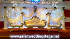wedding cake table and backdrop | Gold and white swag and backdrop wedding stage at Asian Wedding Stage