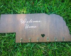 Laser cut Nebraska key hook sign. https://www.etsy.com/shop/fitchmakes #maker #makerspace #tinker #tinkerlab #lasercutting #lasercut #engraved #etched #etsy #etsyshop #estyseller #folk #handmade #wood #diy #nebraska #home