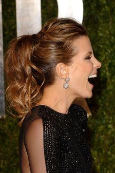 Best Oscars Hairstyle: Kate Beckinsale's Bouncy Ponytail In 2011, Kate Beckinsale turned a basic ponytail into a sexy and easy updo by adding a bouffant for extra height and curling the ends for a flirty touch.