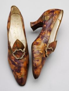 Ladies' buckle shoes, ca. 1910s. Probably made in France; sold in London; by Thierry. Faux leather with printed marble design of brown, purple, orange, and bronze, lined with linen and kid leather. V & A Museum.
