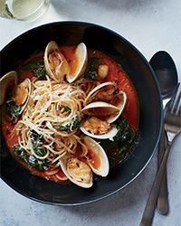 This classic, briny dish of spaghetti with fresh clam sauce gets amped up with sweet roasted bell peppers and Swiss chard.