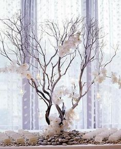 This could be done with Manzanita branches and paper flowers.The cabin is surrounded by Manzanita! ~HC