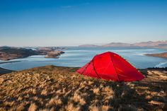 Wild camping on the summit of Ben Lora with a view of the Isle of Mull, Scotland. ImagePaul McGee / Moment / Getty Images