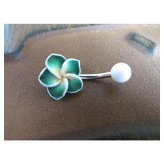 Green Hawaiian Flower Plumeria Belly Button Ring Hawaii Navel Stud... ❤ liked on Polyvore featuring jewelry, studded jewelry, flower jewelry, flower jewellery, surgical steel jewelry and blossom jewelry