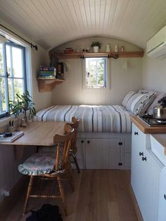 small spaces bed and mini kitchen