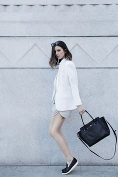 Minimal trends | White jacket grey shorts, flats and a handbag