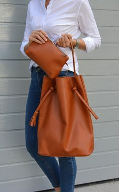 Items similar to Very Capacious Genuine Leather Broad Shopper, Minimalistic Style Raw Finish Leather Tote For Women, Hobo, Dark Camel Leather Bag on Etsy Best Bags, New Fashion Trends, New Bag, Cute Bags, Leather Purses, Leather Bags, Natural Leather, Beautiful Bags, Bucket Bag