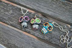 Sugar Skull Pendants by artist Kerry C. www.facebook.com/sugarskullshoppe