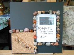 this was a faded craft board.i put a layer of chalkboard paint on entire front side.added the corkboard with glazed rock ended push pins,added rocks around cork and photo frame opening. tri- purpose photo/cork/chalk board.