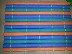 Safety mat made from pool noodles!! Way cheaper than regular floor mats & can be reused later! Grab some noodles from the dollar store & tie them together (like a raft). Great for indoor jungle gyms or anywhere your little ones could use as little extra protection..