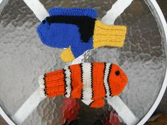 Ravelry: Debbie4's Nemo and Dory-too cute! She adapted a basic mitten pattern for this winning combination