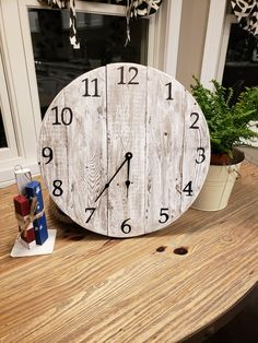 "Get the farmhouse rustic look with this 15"" wooden clock created with old fence posts. Www.denimnheels.com"