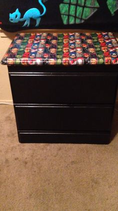 Avengers dresser done with wrapping paper and mod podge