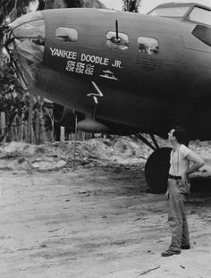"""B-17 Flying Fortress 'Yankee Doodle, Jr.'  WWII photo of the B-17 Flying Fortress aircraft """"Yankee Doodle, Jr."""", which had the enviable record of having sunk a Japanese cruiser and a transport. The flags painted on the nose of the aircraft indicate Zeros shot down in South Pacific combat."""