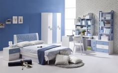 Interior: White And Blue Bedroom Design With Study Desk And Bookcase Also Bed Chusion And Side Table Plus Circle Fur Rug And Wardrobe: Best White and Blue Interior Decorating Design ideas