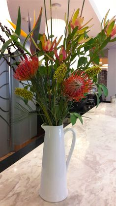 Leucadendrons are looking colourful and gorgeous at this time of year. They also work incredibly well with the orange pincushions and Strelizia. Venus is always a winner in vase arrangements as they last so long. These are arrangements designed for Protea Hotel in Sea Point. #texture #colour #flowers #fynbos #bouquet #fabulousfynbos #blooms #proteas #instaflowers
