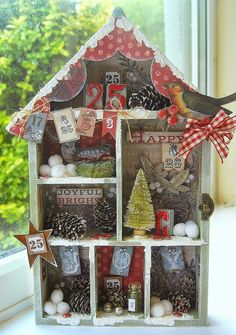 Stunning home decor little Christmas house. Decorated with paints, papers and embellished beautifully. Love the traditional colours and the robin design, all the bits and pieces and natural pine cones.