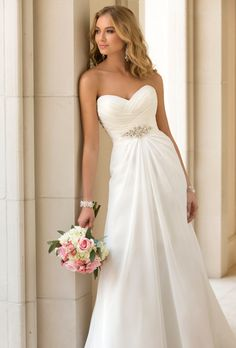 Stella York. Sheath gown in capri chiffon featuring a ruched bodice and diamante beading detailing below the bust.��More Details From Stella York