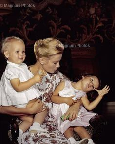 Grace Kelly - Princess of Monaco -with, I believe, her children's names were Caroline & Albert. In the 1960's my daughter wrote to Prince Ranier and he 'wrote' back to her and sent her pictures. She was thrilled and took them to 'show & tell' in school.