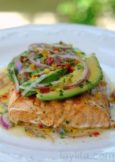 #paleo Grilled salmon with avocado salsa: 2 lbs salmon, cut into 4 pieces; 1 tbs olive oil; 1 tsp salt; 1 tsp ground coriander; 1 tsp ground cumin; 1 tsp paprika powder; 1 tsp onion powder; 1 tsp black pepper | Avocado salsa: 1 avocado, peeled, seeded and sliced; 1 small red onion, sliced; 3 mild hot peppers, seeded and deveined, diced or sliced; Juice from 2 limes; 3 tbs olive oil; 2 tbs finely chopped cilantro; Salt to taste