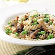Pasta with Creamy Mushroom-Pea Sauce Recipe.  Whitney, Austin will prob love this recipe.