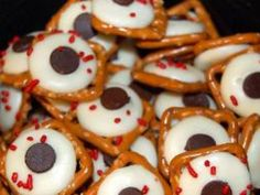 Edible Eyeballs - A scary, Halloween treat sure to please your kids--pretzels with white chocolate eyeballs and chocolate chip pupils.